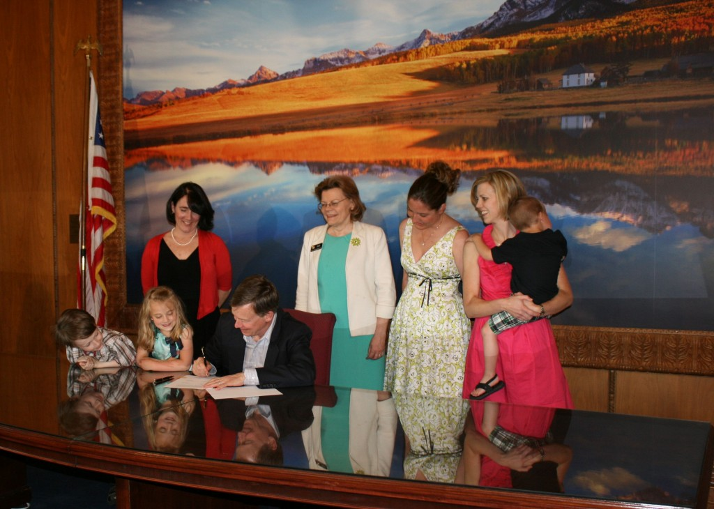 Governor John Hickenlooper signing our bill